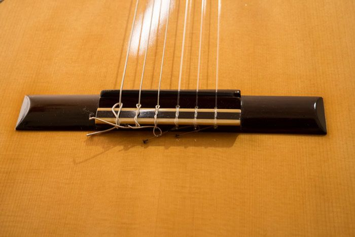Il ponte fisso della chitarra classica Guagliardo